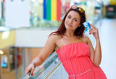 Attractive red hair woman with credit cards — Stock Photo