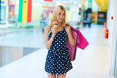 Teen girl with ice cream and shopping bags — Stock Photo