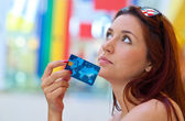 Attractive woman with credit card — Stock Photo
