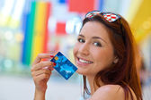 Red hair woman holding credit card — Stock Photo