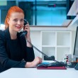 Attractive business woman in office on phone — Stock Photo #48901865