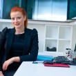 Attractive business woman in office cubicle — Stock Photo #48901933