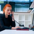 Attractive business woman in office cubicle on the phone — Stock Photo #48902159
