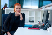 Attractive business woman in office cubicle — Foto de Stock