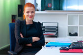 Attractive business woman in office cubicle — Stok fotoğraf