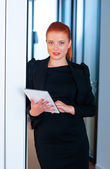 Red hair business woman with tablet in office — Stock Photo
