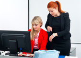 Two nervous colleague workers in office with computer — Stock Photo