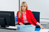 Attractive business woman in office with computer — Stock Photo