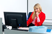 Attractive business woman in office with computer — ストック写真