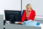 Attractive business woman in office with computer — Foto de Stock