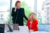 Two business woman in office — Stock Photo