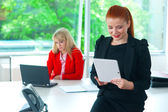 Attractive business woman in office with tablet — Foto de Stock