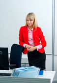 Attractive business woman in office with computer — Stok fotoğraf