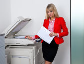 Business woman working on office printer — Stock Photo