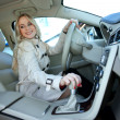 Attractive blond woman in driver seat — Zdjęcie stockowe