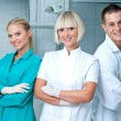 Woman doctor gynecologist or oncologist with assistents — Stock Photo #51392587