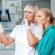 Woman doctor with her assistant — Stock Photo #51392727
