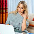 Attractive blond woman writing on laptop — Stock Photo #51392951