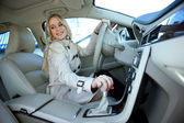 Attractive blond woman in driver seat — Stock Photo