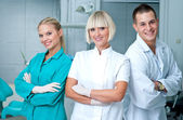 Woman doctor gynecologist or oncologist with assistents — Stock Photo