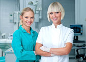 Woman doctor gynecologist or oncologist with assistent — Stock Photo