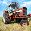 Stock Photo: Old Farm Tractor in Grass Field