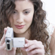 Stock Photo: Teenager filming with her digital video camera.