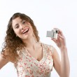 Woman holding a small digital video camera while recording — Stock Photo #19740717