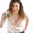 Woman holding a small digital video camera while recording — Stock Photo