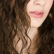 Beauty portrait of a young hispanic girl half face with dark curly hair — Stock Photo