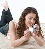 Woman recording with a small digital video camera — Stock Photo