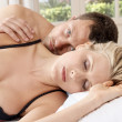Close up of a young couple in bed. — Stock Photo