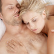Young couple sleeping together in bed. — Stock Photo