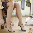 Close up of a young sophisticated woman tryin on new shoes in a fashion store. — Stock Photo #19804827