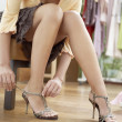 Close up of a young sophisticated woman tryin on new shoes in a fashion store. — Stock Photo #19804839