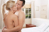 Nude couple hugging in bedroom. — Stock Photo