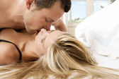 Young couple passionately kissing in bed. — Stockfoto