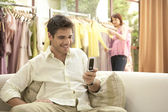Man waiting for woman, shopping in a fashion store. — Stock Photo