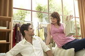 Couple with shopping bag in fashion store. — Stock Photo