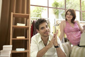 Man treating his girlfriend to a gift in fashion store. — Stock Photo