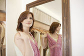 Woman trying new clothes in fashion store, looking at camera. — Stock Photo