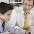 Father and son working on a computer. — Stock Photo