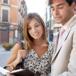 Businessman and businesswoman having a meeting outdoors in a classic city — Stock Photo #20076677