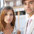 Portrait of a businessman and a businesswoman standing together in a classic office buildings street. — Stock Photo #20076687