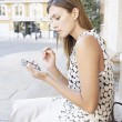 Young woman using a smart phone in a European city. — Stock Photo