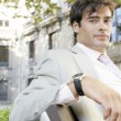 Portrait of a young businessman with a European city background. — Stock Photo