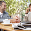 Two businessmen having a meeting in a coffee shop terrace outdoors. — Stock Photo
