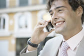 Young businessman talking on a cell phone in the city. — Stock Photo