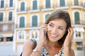 Attractive businesswoman having a conversatioin on her cell phone outdoors — Stock Photo