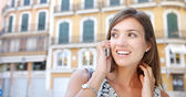 Panoramic view of an attractive businesswoman having a conversation on her cell phone while outdoors — Stock Photo